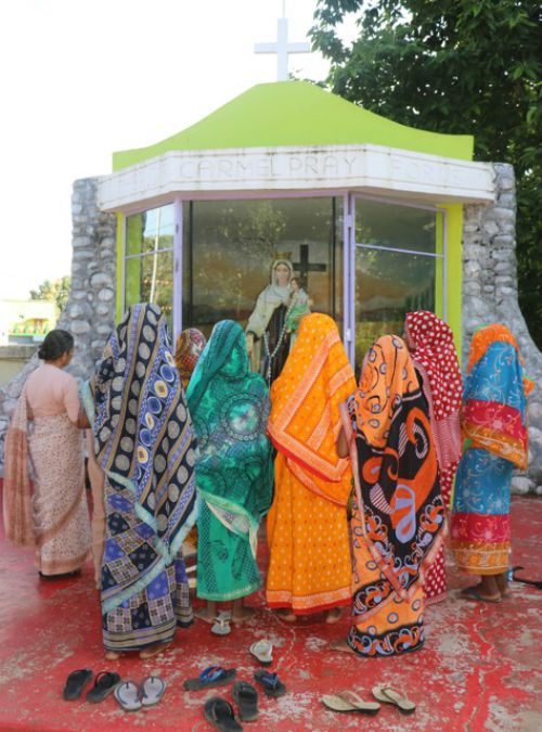 Wives of seven Christians, who were controversially convicted for the 2008 murder of  Hindu leader Swami Lakshmanananda Saraswati, pray Aug. 11 at Carmel convent in Balliguda, India.