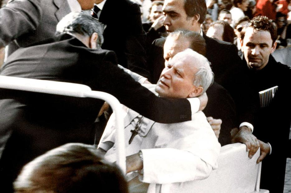 Bodyguards hold Pope John Paul II after he was shot May 13, 1981, in Saint Peter's Square.