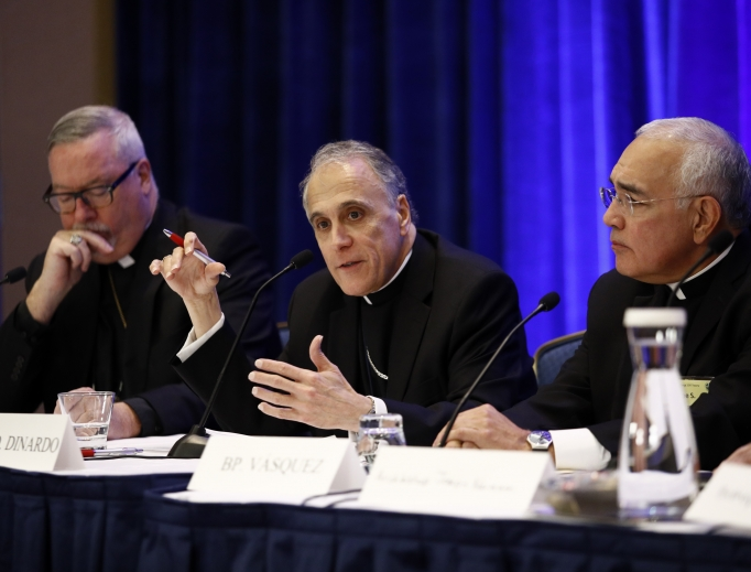 Above, Cardinal Daniel DiNardo of the Archdiocese of Galveston-Houston (c), the president of the U.S. Conference of Catholic Bishops, speaks at a news conference flanked by Bishop Christopher Coyne of Burlington, Vermont (l), and Bishop Joe Vasquez of Austin, Texas, during the USCCB's annual fall meeting in Baltimore Nov. 13. Below, the bishops gather at Mass at the Baltimore basilica.