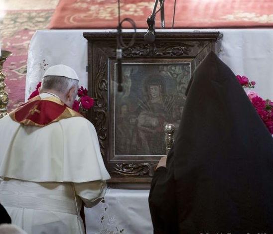 Pope Francis and Catholicos Karekin II pray at the Armenian Apostolic Cathedral in Gyumri on June 25, 2016.