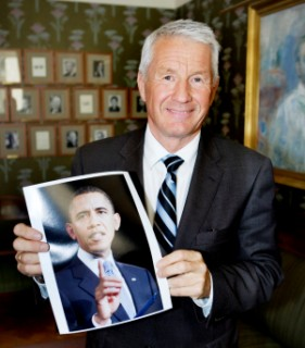 Thorbjoern Jagland, chairman of the Norwegian Nobel Committee, holds a picture of President Obama Oct. 9.