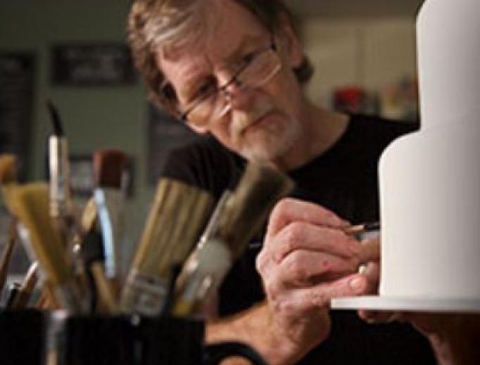 Baker Jack Phillips works on a cake, as his creativity reflects his Christian faith.