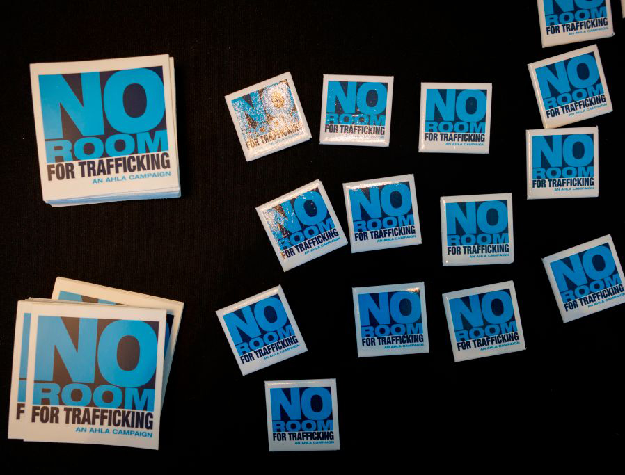 """The """"No Room for Trafficking"""" campaign logo is seen during a Jan. 9, 2020, meeting to prevent human trafficking in Miami, Florida — the site of Super Bowl LIV."""