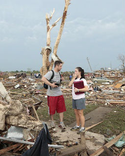 Carlos and Kim Caudillo stand in the debris of their home after a powerful tornado ripped through the area on May 20 in Moore, Okla.