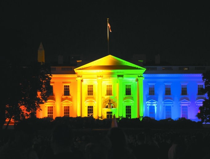 The Obama White House is lit up in rainbow colors following the U.S. Supreme Court ruling declaring marriage a fundamental right for same-sex couples.