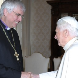 Pope Benedict XVI greets Lutheran Bishop Johannes Friedrich of Bavaria during a meeting with a delegation from the German Evangelical (Lutheran) Church at the Vatican Jan. 24.