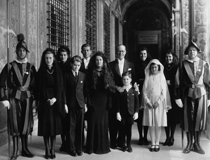 Joseph Kennedy, the U.S. ambassador to London, and Mrs. Rose Kennedy, with their children, photographed as they left Vatican City March 20, 1939, after Pope Pius XII had received them in a private audience.