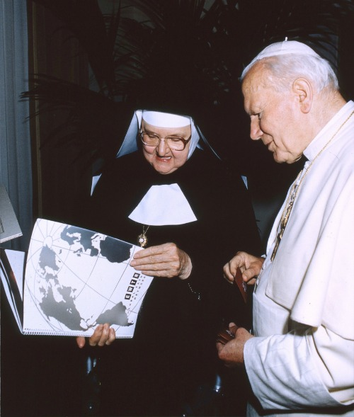 Mother Angelica briefs Pope John Paul II about aspects of EWTN's operations.