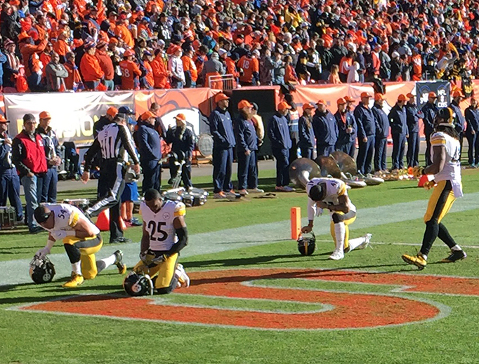 Pittsburgh Steelers kneel for higher reasons before a playoff game in Denver on January 17, 2016.