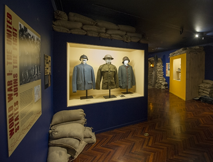 World War I uniforms (above) and a model of a 'K of C Hut' (below), complete with portable altar for Mass, are on display as part of a new Knights of Columbus Museum exhibit in New Haven, Connecticut.