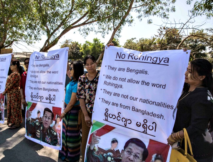 Ma Ba Tha Buddhists protest the use of the word 'Rohingya' as a Rakhine donation ship from Malaysia arrives Feb. 9 in Yangon, Burma. The Rohingya aid ship, Nautical Aliya, landed at Thilawa port near Yangon while making its way to the Rohingya refugee camps in Myanmar and Bangladesh, bearing 2,300 tons of food, clothes and medical supplies for the Rohingyas in the two countries. Below, Cardinal Charles Maung Bo of Myanmar has spoken with Pope Francis on alleviating the suffering of this Muslim minority.