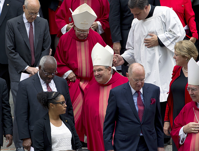 U.S. Supreme Court Justices Stephen Breyer, left, Clarence Thomas, center, and Anthony M. Kennedy, right, leave St. Mathews Cathedral, after the Red Mass in Washington on Sunday, Oct. 2, 2016. The Supreme Court's new term starts Monday, Oct. 3.