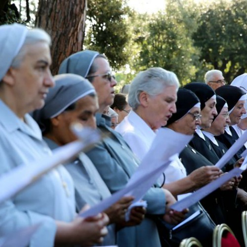 Religious sisters attend the enthronement of Our Lady of Charity in the Vatican Gardens on Aug. 28.