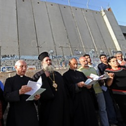 Christian leaders pray in front of the Israeli separation wall near Rachel's Tomb in Bethlehem, West Bank.