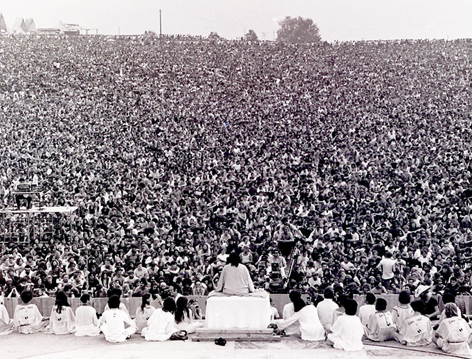 """""""Woodstock Guru"""" Swami Satchidananda delivers a speech and leads the crowd in a chant to open the Woodstock Festival, Aug. 15, 1969."""