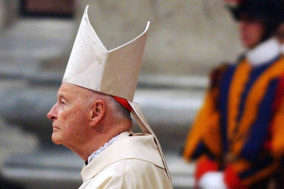 With the Swiss Guard looking on, then-Cardinal Theodore McCarrick participates in a Novemdiales Mass in St. Peter's Basilica Apri 16, 2005, in Vatican City.