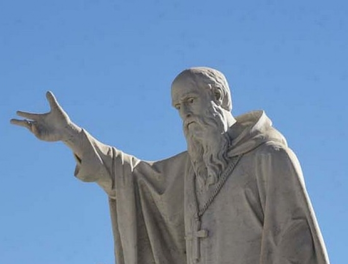 Above, a statue of St. Benedict inn Italy