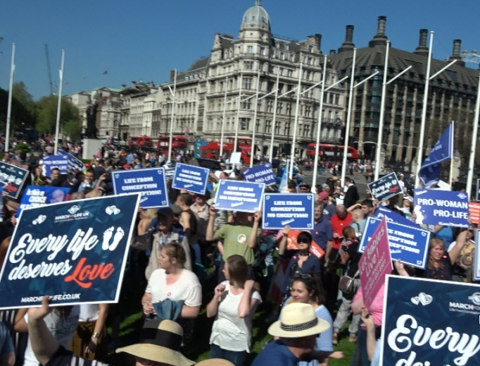 Above, March for Life UK participants descend on Parliament Square in London. Below, more of the thousands of marchers bear pro-life witness May 5.