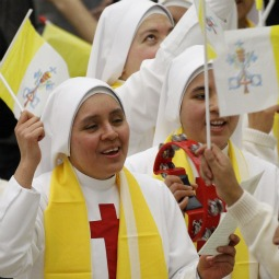 Nuns wave Vatican flags as they cheer prior to Pope Benedict XVI's general audience in Paul VI hall at the Vatican recently.