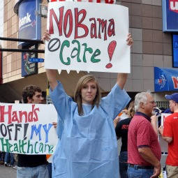 Health Care Reform protesters hold placards outside of Barack Obama's Health Care speech at the Target Center in 2009 in Minneapolis. Now, a key provision that pro-life protesters had feared, is coming to become reality under the new health-care plan.