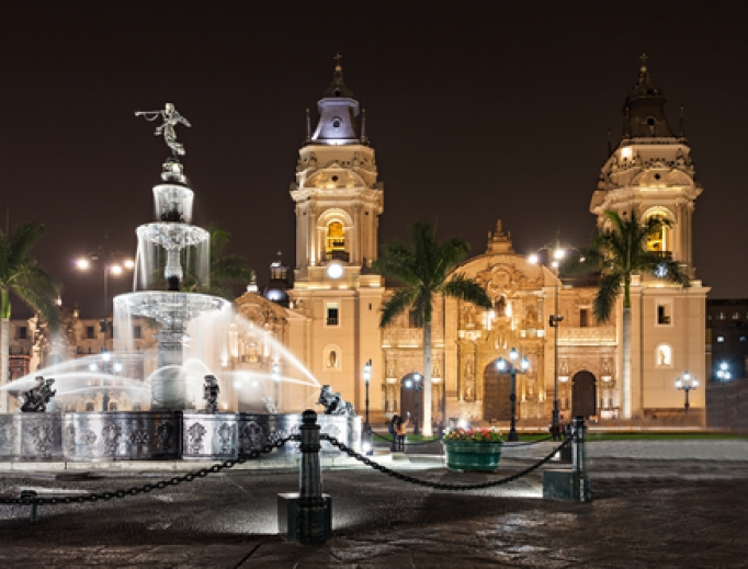 The Basilica Cathedral of Lima at night located in the Plaza Mayor in Lima, Peru.