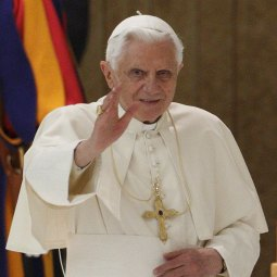 Pope Benedict XVI waves to pilgrims as he arrives for his general audience in Paul VI hall at the Vatican Nov. 10.