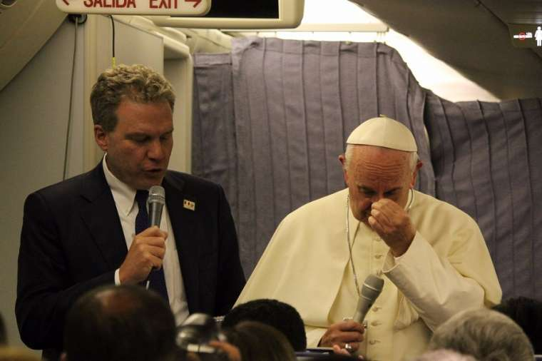 Pope Francis speaks aboard the papal plane from Lima, Peru, to Rome Jan. 22