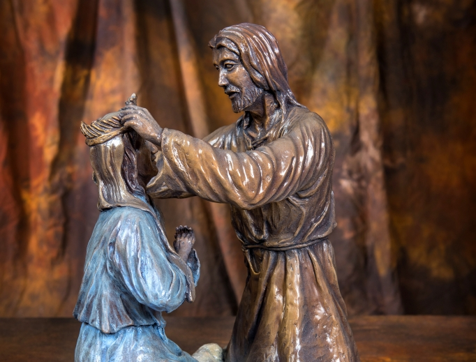 Above, the Coronation in bronze. Below, Mother Teresa statue greets the faithful at St. Patrick's in New York; the sculptor and his wife, Judy, with the statue. Below, more Rosary casts, of the Nativity and Last Supper.