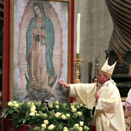 Pope Francis touches an image of Our Lady of Guadalupe at St. Peter's Basilica Dec. 12, 2014.