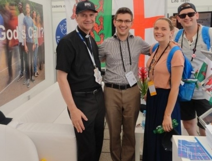 Above, Father Christopher Jamison, Peter and an engaged couple, Michaela and Patrick, at the England and Wales tent. Below, Father Witold and Brother Tomasz