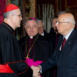 Cardinal Tarcisio Bertone, Vatican secretary of state, delivers Pope Benedict XVI's well wishes to Italian President Giorgio Napolitano at the Vatican March 16, the day before Italy marked the 150th anniversary of its unification.