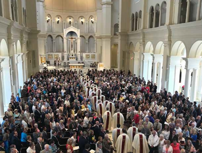 Priests process in for the July 26 Mass of dedication at Holy Name of Jesus Cathedral in Raleigh, North Carolina.