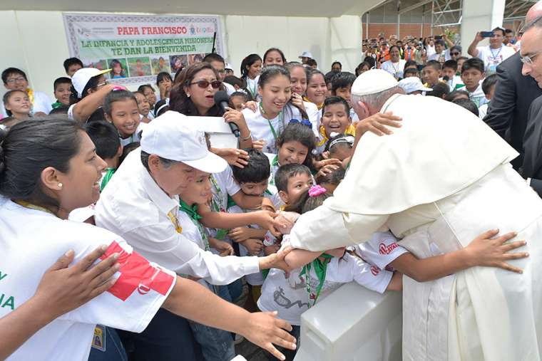 Pope Francis is greeted by a crowd at Padre Aldamiz International Airport in Puerto Maldonado, Peru, Jan. 19.