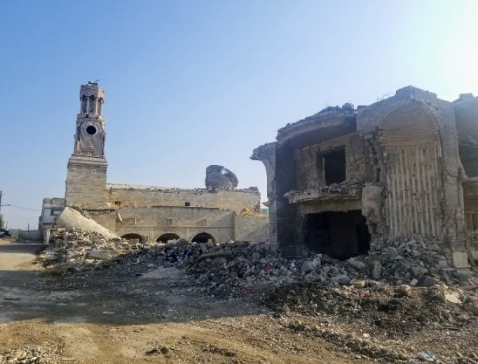 Above, Mosul's destroyed Chaldean Catholic archbishopric is shown.