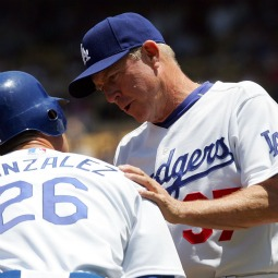 Assistant coach Rich Donnelly of the Los Angeles Dodgers talks with Luis Gonzalez during the game against the Florida Marlins at Dodger Stadium on July 8, 2007, in Los Angeles.