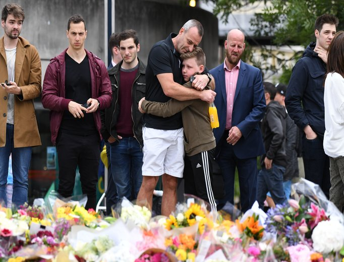 Members of the public mourn before a makeshift memorial near London Bridge June 5.