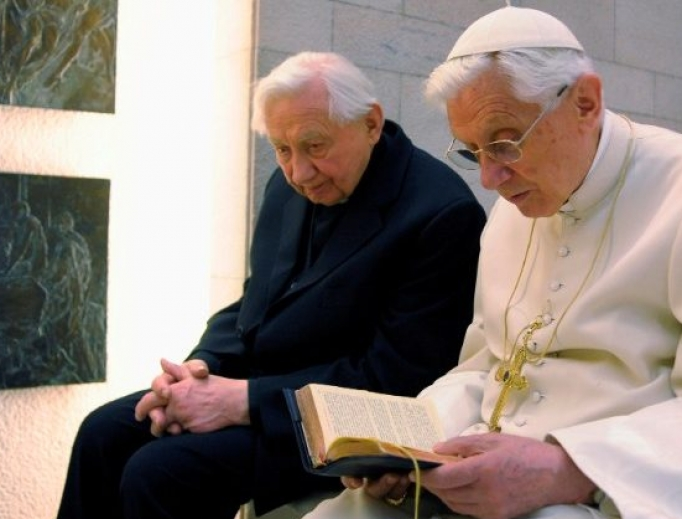 Pope Benedict XVI prays with his brother, Msgr. Georg Ratzinger, in his private chapel at the Vatican.