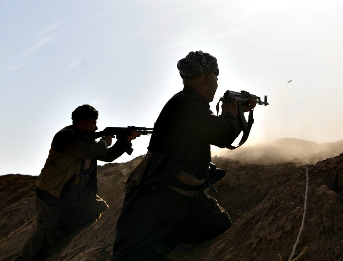 Kurdish peshmerga fighters fire at an ISIS position during an assault to recapture the village of Tiskharab, near Mosul, Iraq, on Oct. 20. Kurdish and Iraqi forces, supported by numerous countries, including Britain and the USA, have continued their advance towards towards Iraq's second-largest city of Mosul, which has been held by Islamic State militants since 2014.