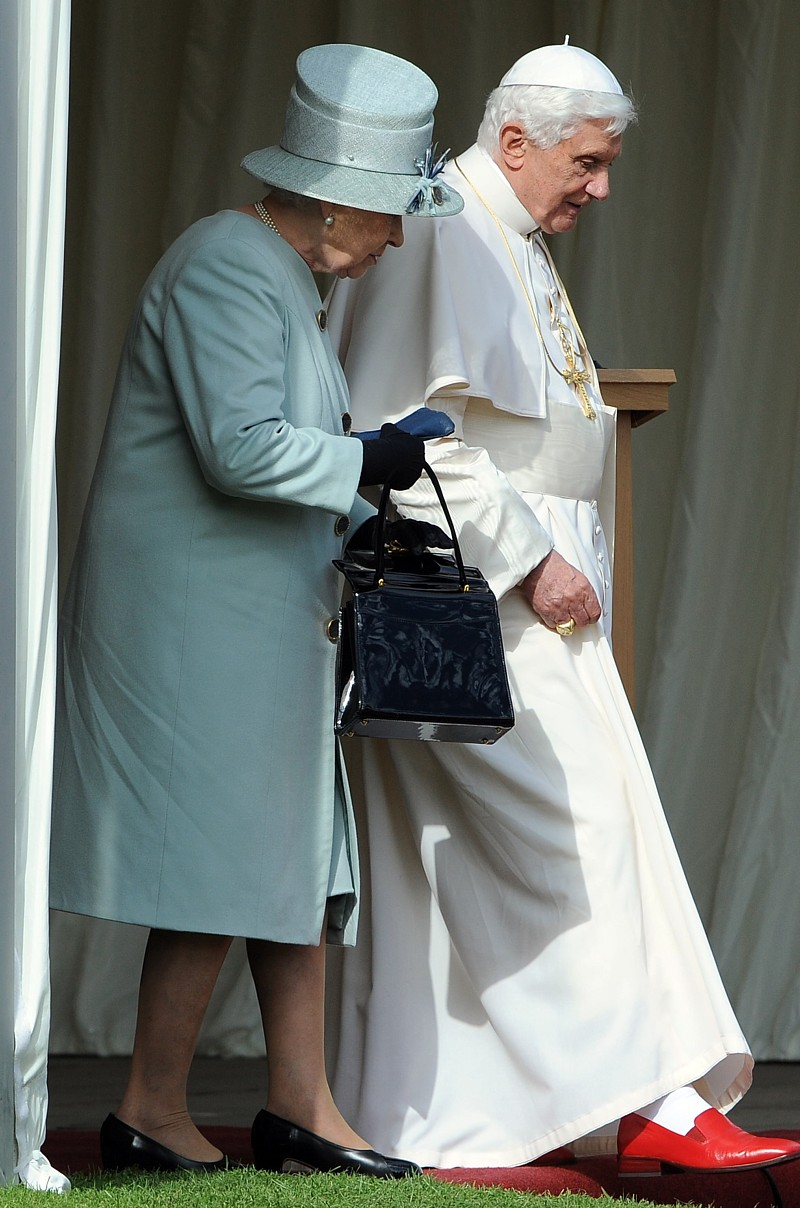 Britain's Queen Elizabeth II and Pope Benedict XVI walk through the gardens at the Royal Palace of Holyroodhouse in Edinburgh, Scotland, Sept. 16.