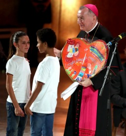 Archbishop Pietro Parolin, the Vatican's Secretary of State, participating with two children at a Dec. 2 benefit concert at the Vatican for the Bambino Gesu pediatric hospital.