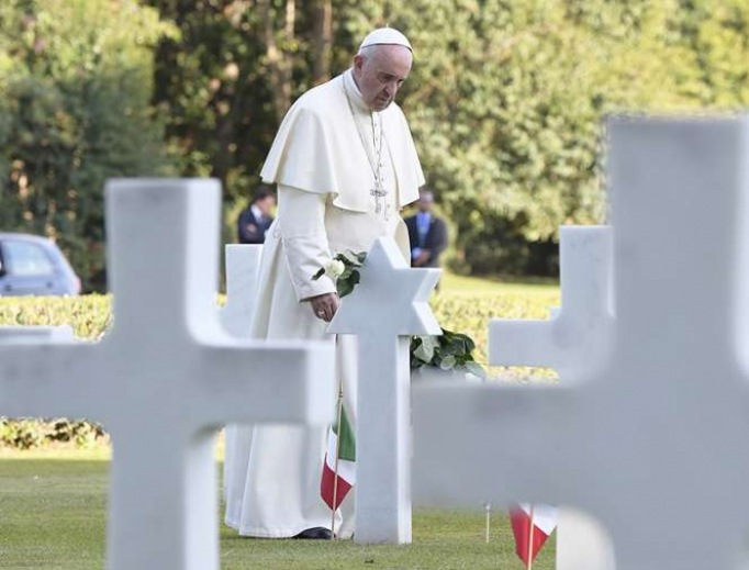 Pope Francis visits graves at the Sicily-Rome American Cemetery in Nettuno, Italy, Nov. 2, 2017.