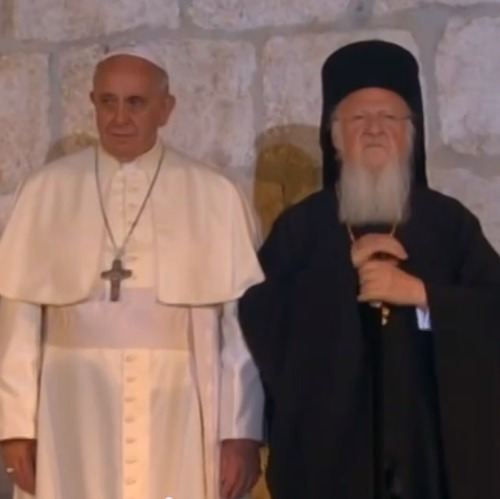 Pope Francis and Ecumenical Patriarch Bartholomew I stand together at the beginning of the May 25 ecumenical celebration at the Church of the Holy Sepulchre.