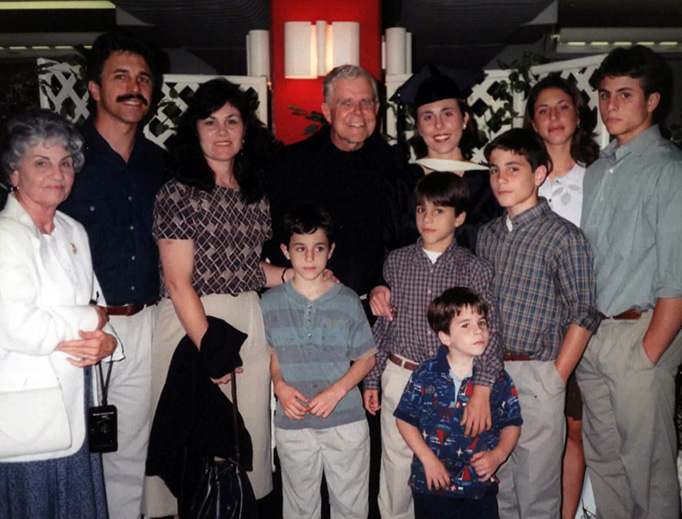 Fr. Michael Scanlan (back row, center), Jeanette DeMelo (third from right) and family at Franciscan University of Steubenville in 1998.