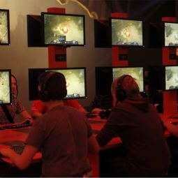 Visitors play ''Blizzard Entertainment-Diablo'' at their exhibition stand at the Gamescom 2010 convention, Europe's largest video games trade fair, in Cologne August 19, 2010.