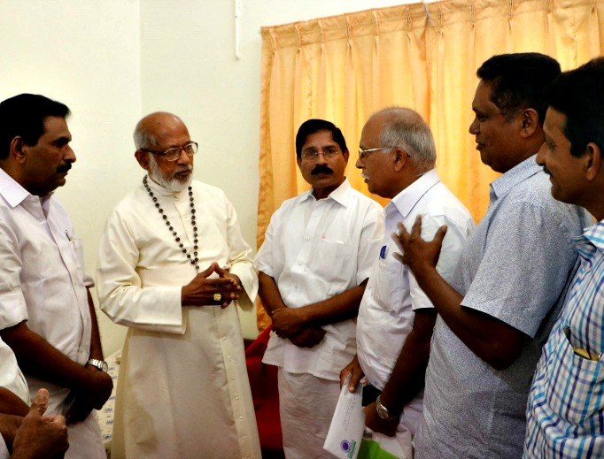 Cousins of kidnapped Salesian Fatherr Tom Uzhunnalil meet with Cardinal George Alencherry, second from left, major archbishop of the Syro-Malabar Catholic Church in Kerala, at Mukkootuthara, on Dec. 29.