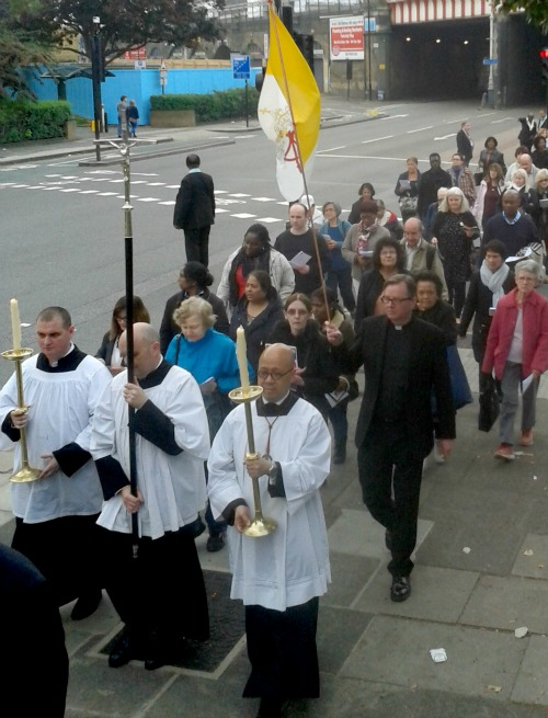 A Eucharistic procession makes its way through London marking the five-year anniversary of Cardinal John Henry Newman's beatification.