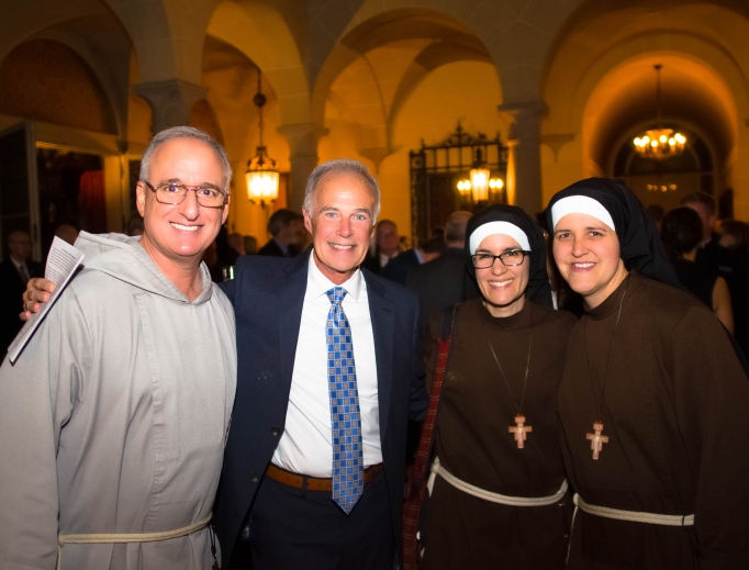 L to R: Father Bob Lombardo of the Franciscan Friars of the Renewal, Jeff Karls and Sisters Alicia and Kate from the Franciscans of the Eucharist of Chicago at the Institute on Religious Life Mystical Rose Gala in November 2019.