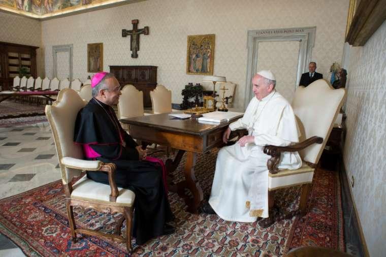 Archbishop Edgar Peña Parra meets with Pope Francis in Vatican City Aug. 17.