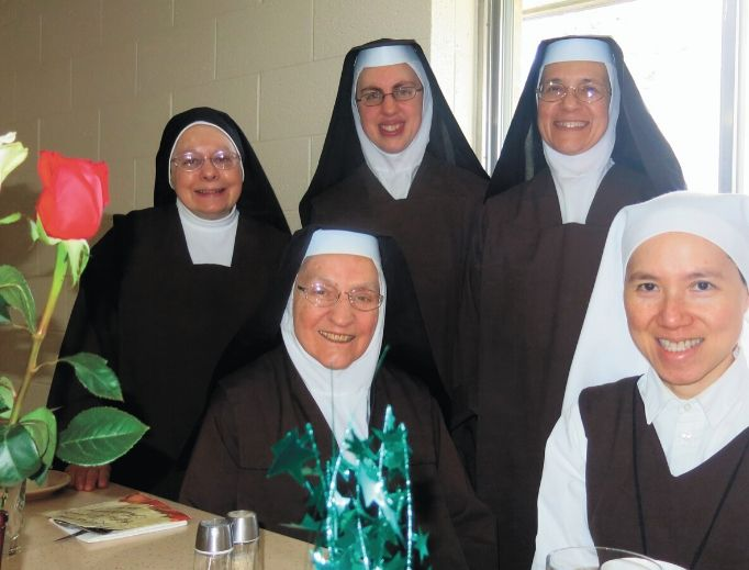 The sisters — shown clockwise from top left: Sister Joseph Marie, 81; Sister Veronica, 38; and Mother Madonna, 54; Sister Theresa Marie, novice, 48; and Sister Margaret Mary, 83 — live their vocations hidden from the world in the Peace Garden State.