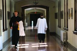 Deacon Evan Harkins, a seminarian from the Diocese of Kansas City-St. Joseph, Mo., walks in the hall as prepares for Mass Feb. 11 at Kenrick-Glennon Seminary in St. Louis.